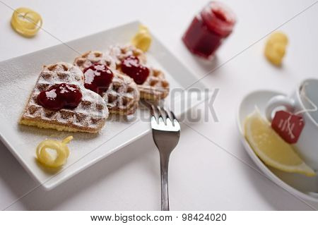 Heart Waffles, Jam, Powdered Sugar Served On Rectangular Plate