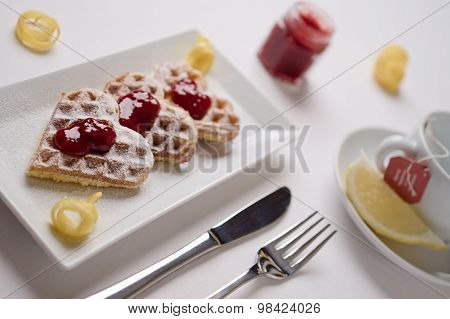 Heart Waffles, Marmalade, Powdered Sugar Served On Rectangular Plate