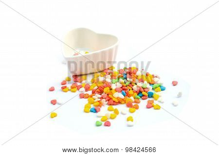 Colorful Heart Cake Sprinkles and Cup in white background