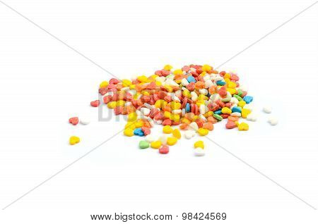 Colorful yellow red and blue Cake Sprinkles decoration in white background