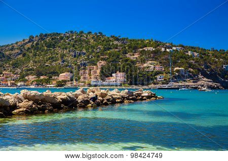 Small Mole Made Of Stones At The Port De Soller