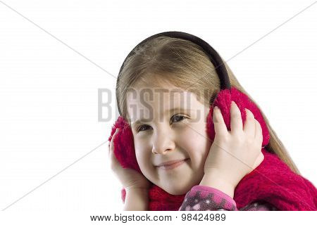 Portrait Of A Girl In Earmuffs And Scarf. Isolated Background.