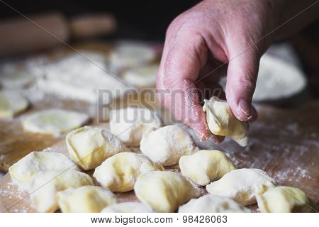 Grandmother Hands At Cooking Vareniki With Cottage Cheese