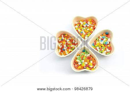Cake Sprinkles in Heart Cup in white background