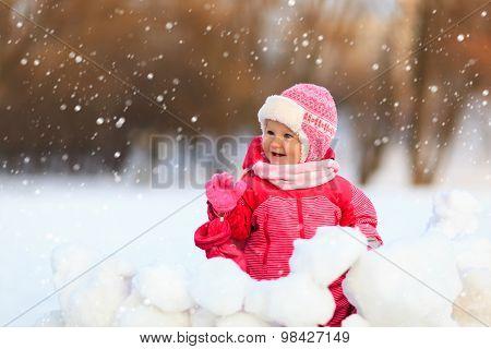cute little girl  play in winter snow