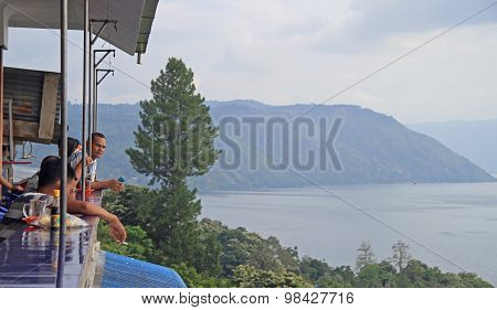 people are watching lake toba from the public oservation deck