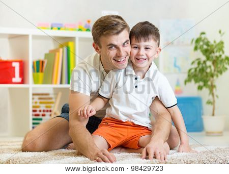 child boy and his dad at home