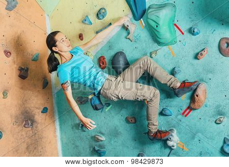 Climber Girl Exercises On Artificial Boulder