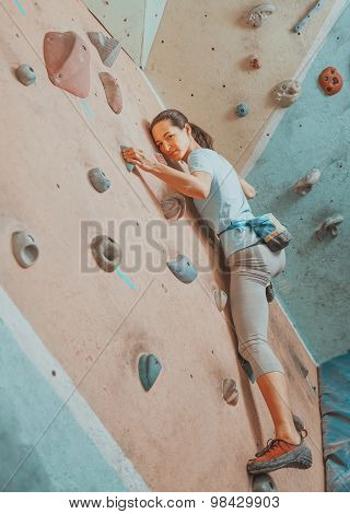 Sporty Girl Climbing On Artificial Boulders