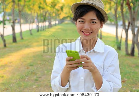 Portrait Of Young Beautiful Asian Woman And Smart Phone In Hand Smiling Toothy Face Connecting Mobil