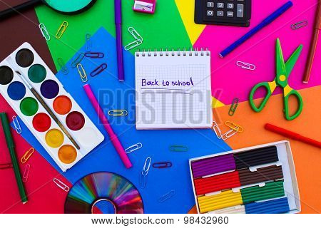 Stationery objects. Office and school supplies on the table. Caption: back to school.