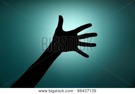 Silhouette of hand close up