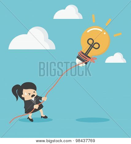 Business Woman Pulling Bulb With Rope