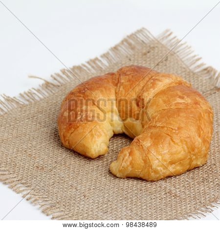 One Croissant On Spuare Frayed Burlap