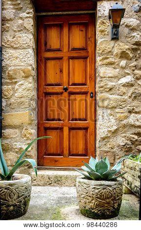 Wooden door  in stone wall.