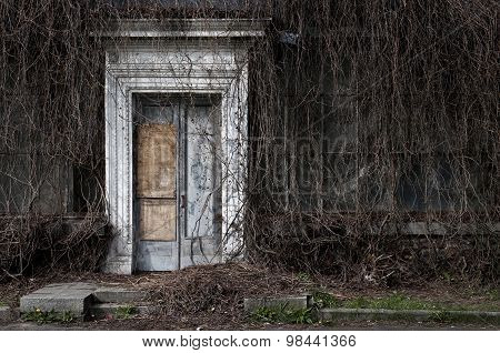 Door to an old abandoned orangery