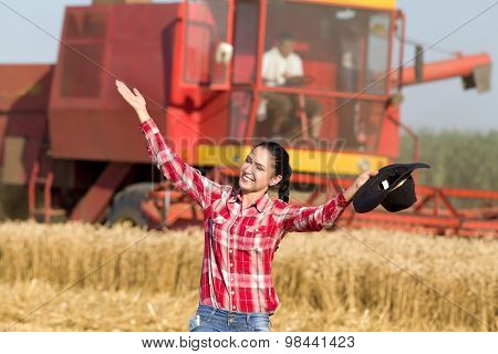Woman With Cowboy Hat In Wheat Field