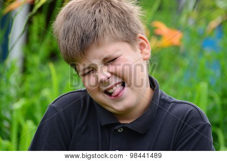 Boy Teenager Face Contorts In Nature