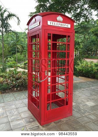 Red payphone box in park