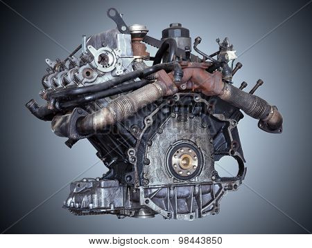 Car engine on grey background