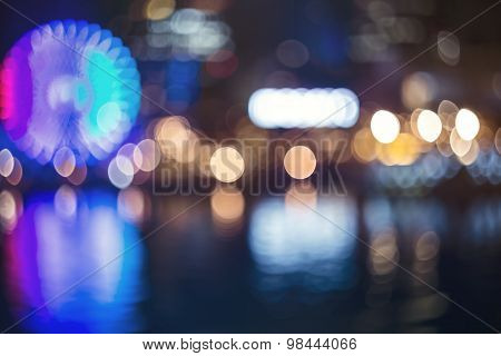 Blurred Bokeh Night Harbor Lights Backdrop With Ferris Wheel