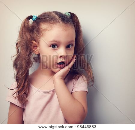 Surprising Cute Kid Girl With Open Mouth Looking Serious. Vintage Portrait