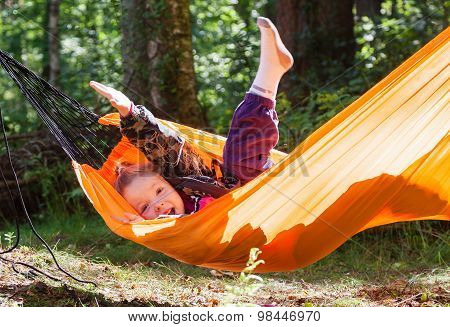Girl Resting In A Hammock