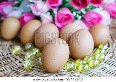 Close Up Chicken Eggs And Rose In Background