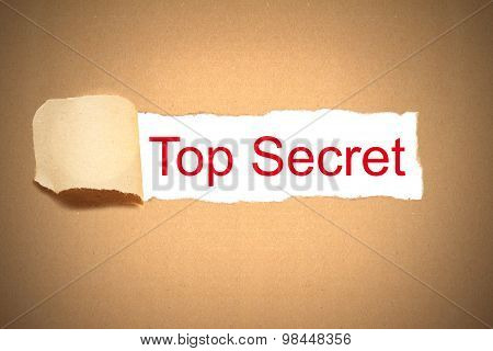Brown Paper Torn To Reveal Top Secret