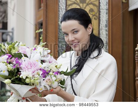 Young Woman With Floral Bouquet
