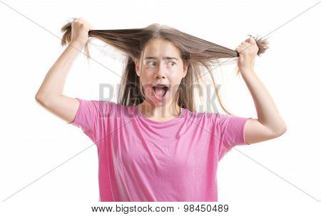 Frustrated Teenage Girl With Braces Pulling Out Her Hair