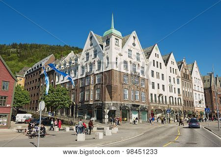 People walk at Bryggen in Bergen, Norway.