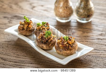 Mushrooms' Caps Stuffed With Mixture Of Cheese, Onion, Breadcrumbs And Butter