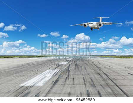 Passenger airplane landing on runway in airport.
