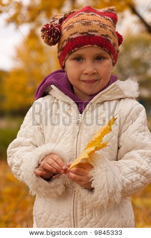 Girl With A Heap Of Leaves