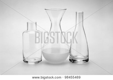 Assorted Glass Bottles of Various Shapes and Sizes on Seamless Background