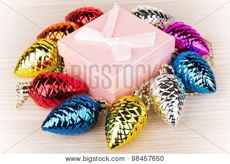Gift Box And Christmas Decorations In Form Of Fir Cones