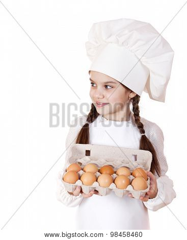 Portrait of a little girl in a white apron holding box of raw eggs, isolated on white background
