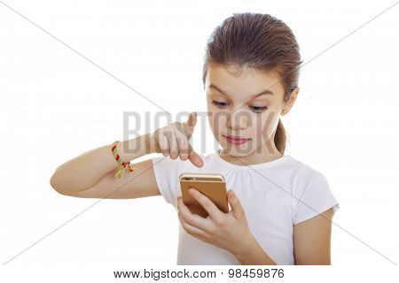 Portrait of brunette Caucasian schoolgirl with mobile phone isolated on white