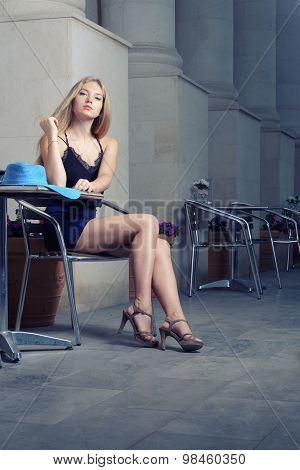 Fashionable stylish young woman wait in cafe