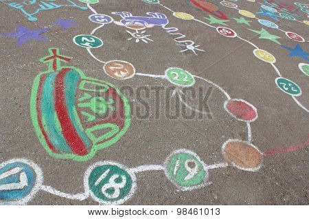 Childish Drawings As A Game On The Asphalt