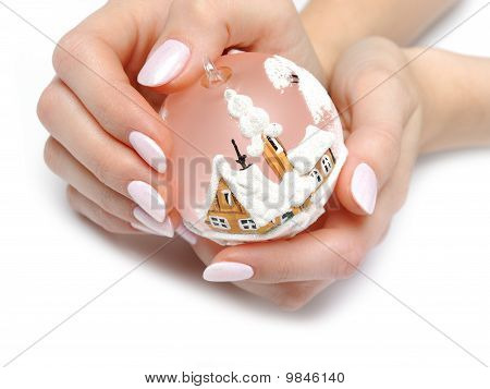Beautiful Hand With Perfect Nail Pink Manicure And Christmas Tree Decoration Ball. Isolated On White