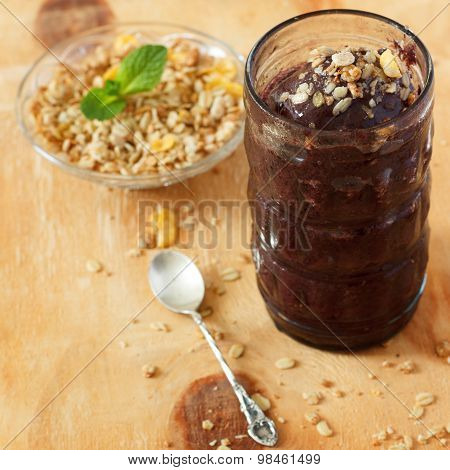 Acai Frozen Pulp Juice In Glass With Muesli