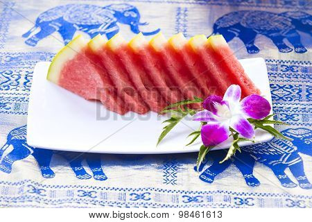 Slices Of Watermelon Served On Plate At Asian Restaurant