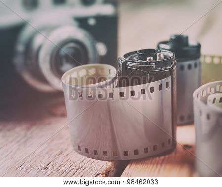 Old Photo Film Rolls, Cassette And Retro Camera On Background. Vintage Styled.