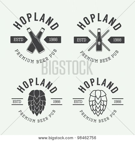 Set Of Vintage Beer And Pub Logos, Labels And Emblems With Bottles, Hops, And Wheat