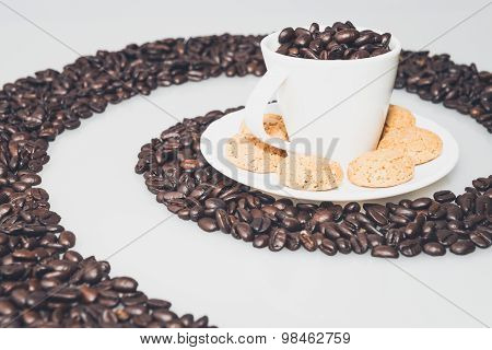Coffee Cup And Cookies In A Coffee Whirl