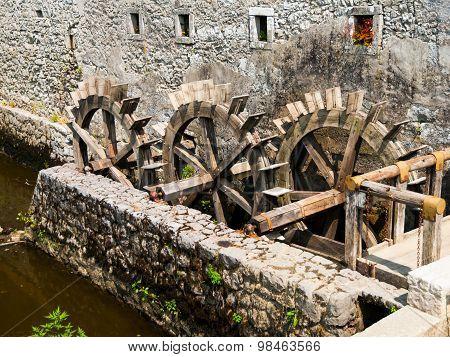 Three wheeled wooden mill