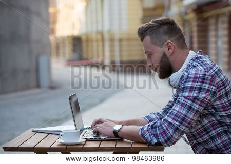 Man freelancer with laptop