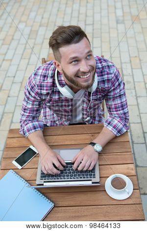 Man freelancer with laptop
